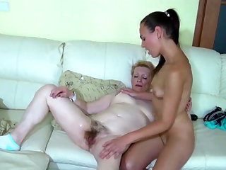 iAmPorn - Granny and brunette babe share dildo