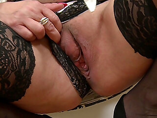 Short haired Kaysha wears stockings and plays with her pussy